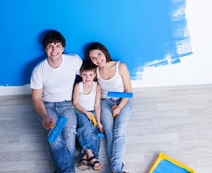 Painting the wall by happy family